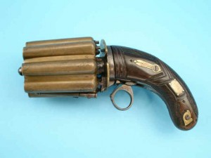 side image of a 16 barrel brass pepperbox
