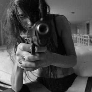 girl in underwear with gun