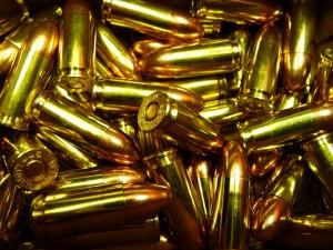 pile of 9mm parabellum cartridges