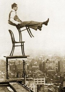 1920 daredevil balancing on the edge of a high building