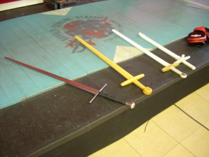 nylon swords next to a blunt practice blade