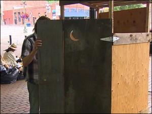 man entering outhouse