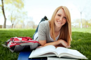 young woman with textbook
