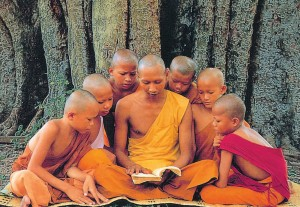 buddhist monk teaching children
