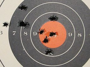 paper target with ragged bullet holes