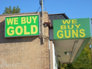 pawn shop sign they buy gold and guns