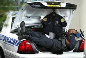 police officer sleeping in the trunk of his cruiser