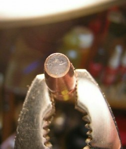 flat nose bullet with lead core exposed