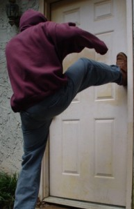 criminal kicking down door