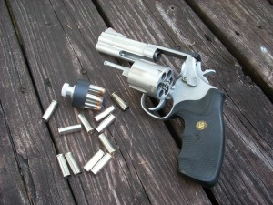 357 magnum with some spent brass and a speed loader