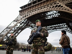 troops guard the eiffel tower