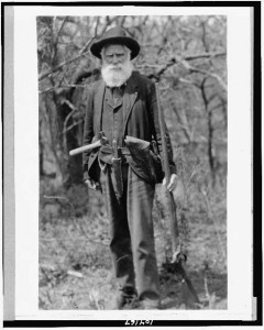 old man with hatchet, musket, and pistol