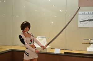 pretty girl with really large japanese sword