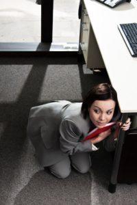 hiding under an office desk